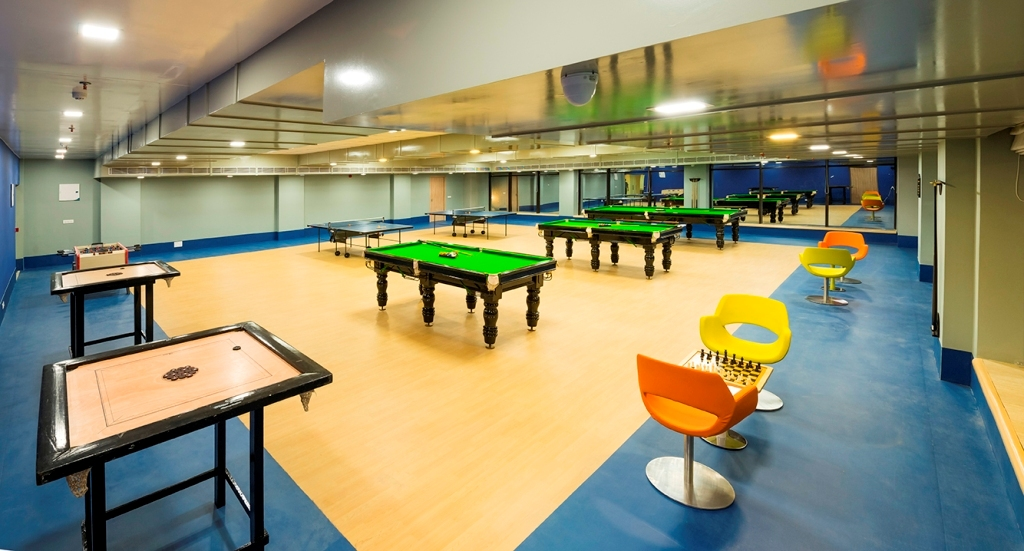Greenfield city royal greens club house for Indoor game room ideas